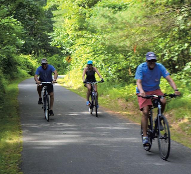 Cyclists on the Warren County Bikeway near Glen Lake