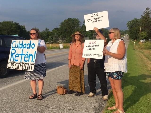 Debra Stoleroff, Laura Ziegler, Bob Jones and Deborah Lang warning motorists about the checkpoint - MATTHEW ROY