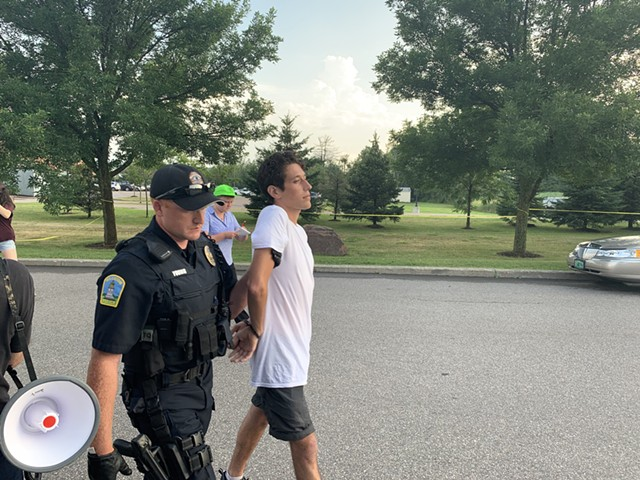 A protester is arrested and cited. - DEREK BROUWER