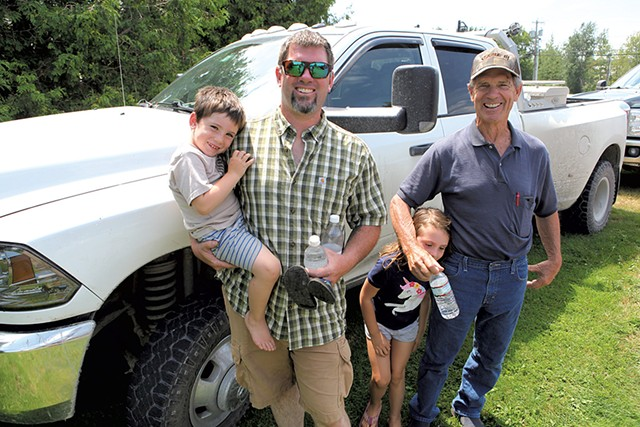 Kurt Magnan, his two kids and his father, Jim Magnan, after the merger vote - KEVIN MCCALLUM