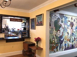 Service counter at Starving Artist Café - JORDAN BARRY
