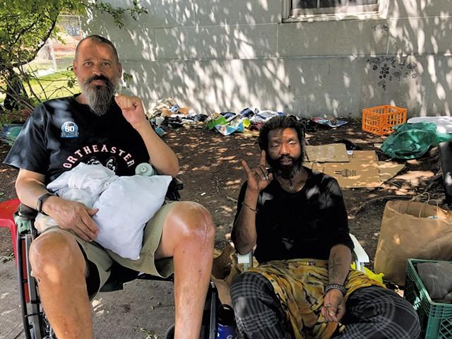 Reuben James Bowen (left) and Dragon next to Burlington City Hall - MOLLY WALSH