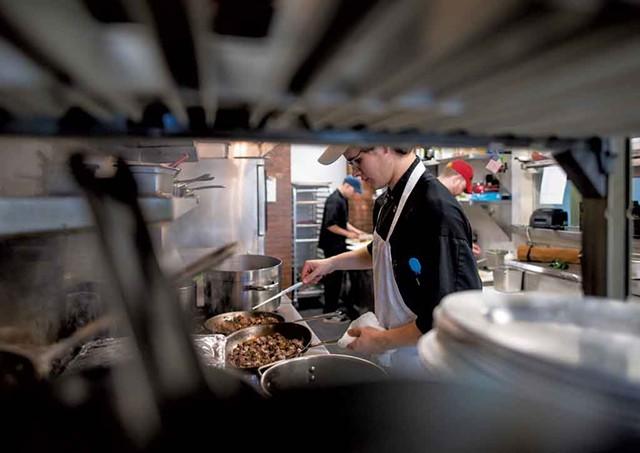 Chef de cuisine Tim Fox sautéing beef at the Inn at Shelburne Farms - GLENN RUSSELL