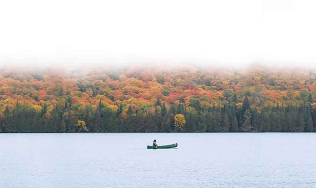 A canoeist out for a morning paddle in the Northeast Kingdom - NATHANAEL ASARO