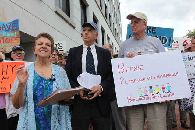 Rosanne Greco (left), a retired Air Force colonel who opposes the F-35, and her attorney, James Dumont, address a crowd in Burlington Thursday. - KEVIN MCCALLUM