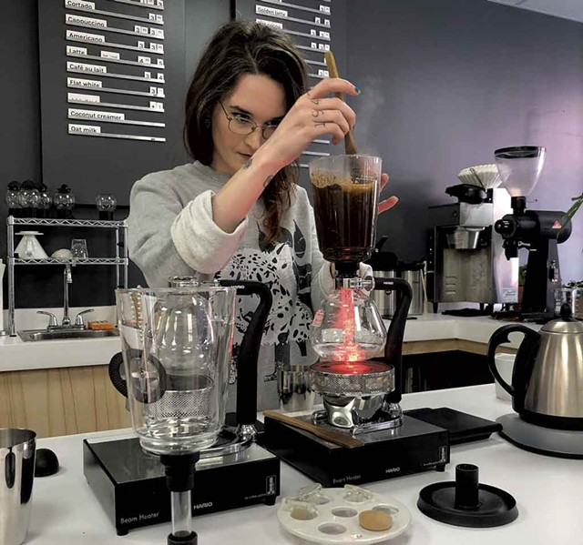 Alice Johnson preparing a siphon at the new location of Catalyst Coffee Bar - JORDAN BARRY