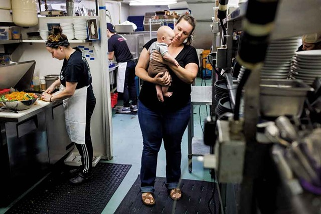 Cara Chigazola Tobin and her 3-month-old son, Gus Tobin, in the Honey Road kitchen - OLIVER PARINI