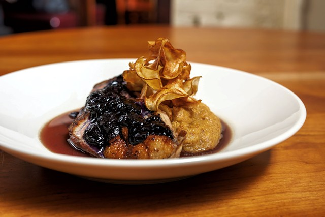 Duck with toasted polenta, a blueberry glaze and sunchoke chips at Sweetwaters - OLIVER PARINI