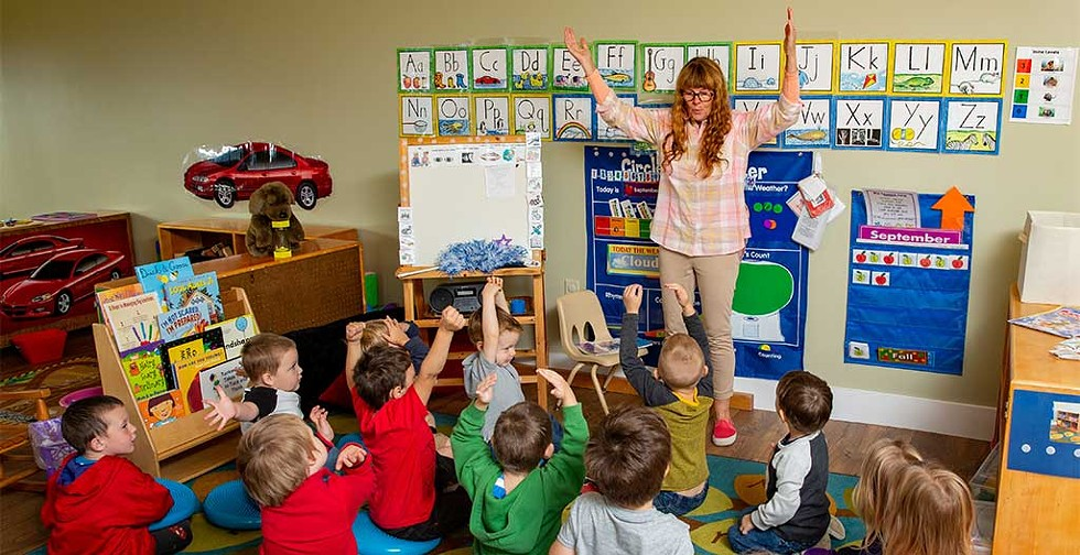Teacher Dolly Spooner telling a story to the kids at the Newport Early Childhood Center - WAYNE TARR