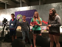 The students show off their squirt-gun stances. - COURTESY OF MICHAEL FISHER