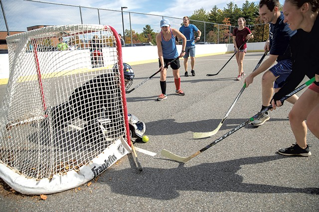 VIP employees playing street hockey - JAMES BUCK