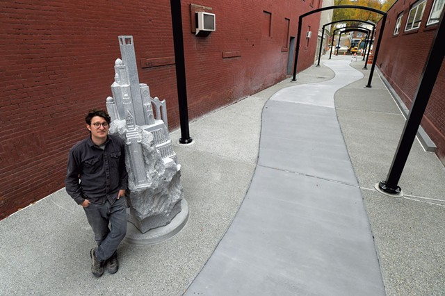 "Sean Hunter Williams with his granite sculpture ""Culmination"" - JEB WALLACE-BRODEUR"