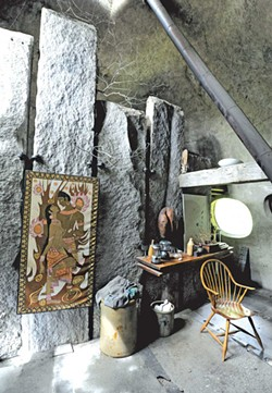 The house has 210 pieces of granite, originally foundation stones from houses dating from the 1800s. Chappelle hand-split and -shaped them. This group of granite slabs forms the bathroom wall. - JEB WALLACE-BRODEUR