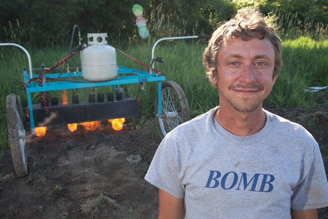 Rob Rock, co-owner of Pitchfork Farms with his flame weeder - MATTHEW THORSEN