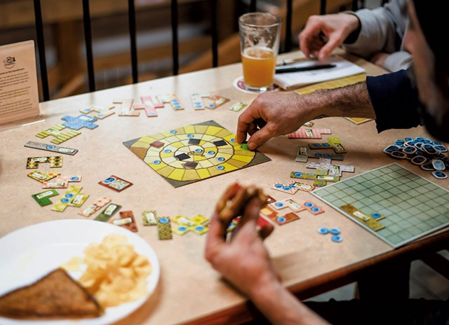 Playing Patchwork at the Boardroom Café - GLENN RUSSELL
