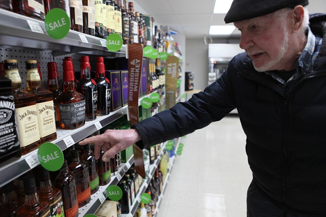 Bill Keogh shops for booze at the Camp Johnson base exchange - KEVIN MCCALLUM