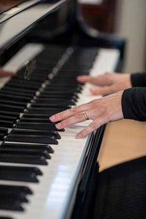 Emily Rose playing piano - CALEB KENNA