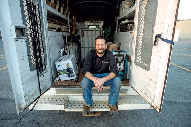 Master plumber Chris Boudreau in the back of his truck - GLENN RUSSELL