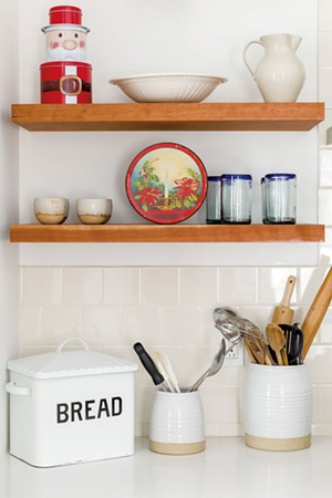 Open shelves create room for storage and holiday displays. - OLIVER PARINI