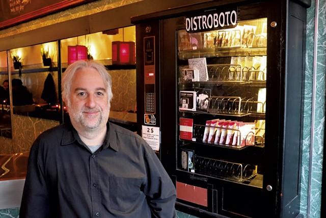 Louis Rastelli and a Distroboto zine vending machine - MARGARET GRAYSON