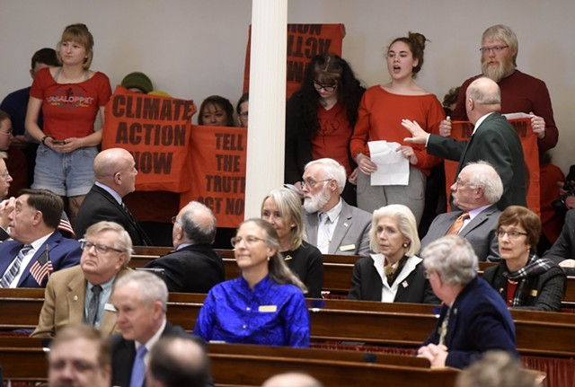 Climate protesters interrupting Gov. Phil Scott's State of the State address - JEB WALLACE-BRODEUR