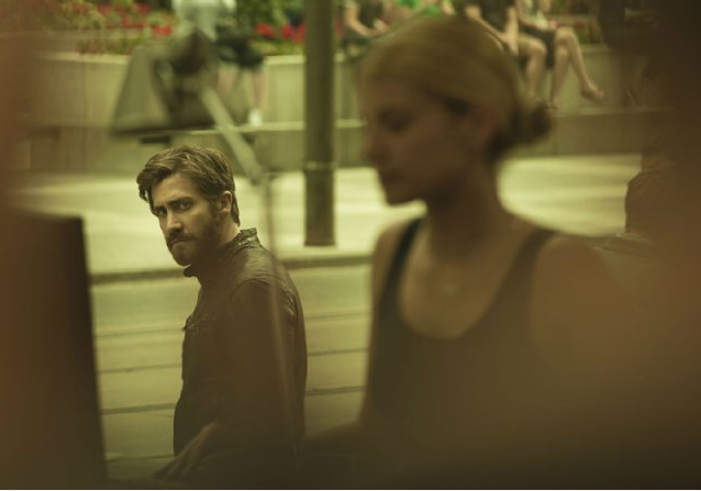 Jake Gyllenhaal stalks the other Jake Gyllenhaal's love interest. - A24 FILMS