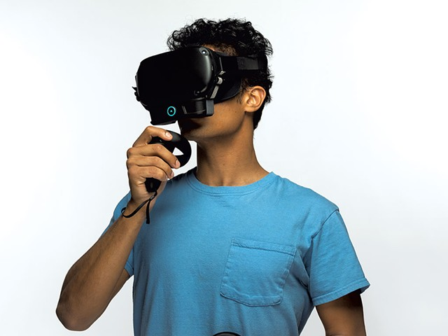 Experiencing scent-enabled virtual reality via the ION device attached to a standard headset - COURTESY OF OVR TECHNOLOGY