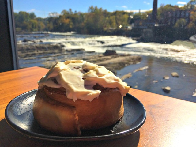 Housemade cinnamon roll ($5) in front of the falls - ALICE LEVITT