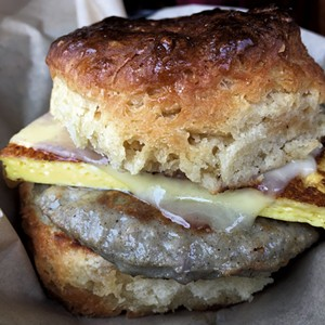 Breakfast sandwich on a maple biscuit at August First Bakery - MELISSA PASANEN