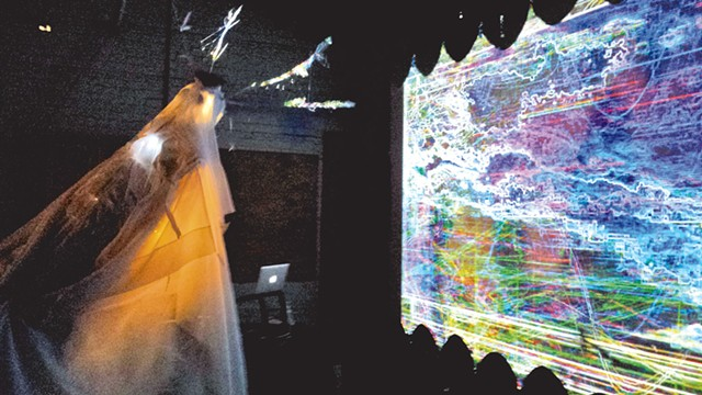 Athena Kafantaris interacting with video  during the Simulacrum Project launch - COURTESY OF LEIF HUNNEMAN