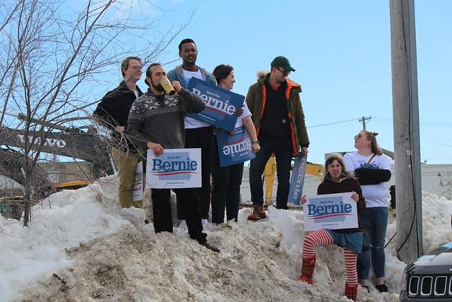 Supporters of Sen. Bernie Sanders watching him speak outside his field office in Cedar Rapids, Iowa - PAUL HEINTZ