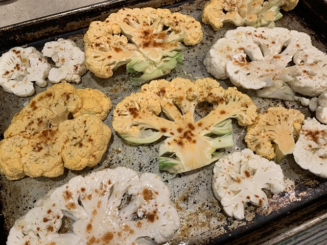 Smoked paprika and honey-brushed cauliflower steaks headed into the oven - MELISSA PASANEN