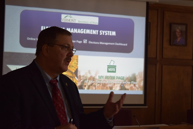 Secretary of State Jim Condos displays a new online voter-registration system Thursday at Montpelier City Hall. - TERRI HALLENBECK