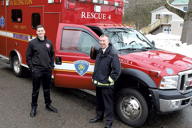 Firefighter Kyle Blake (left) and Fire Chief Steven Locke with the unmanned ambulance - COURTNEY LAMDIN