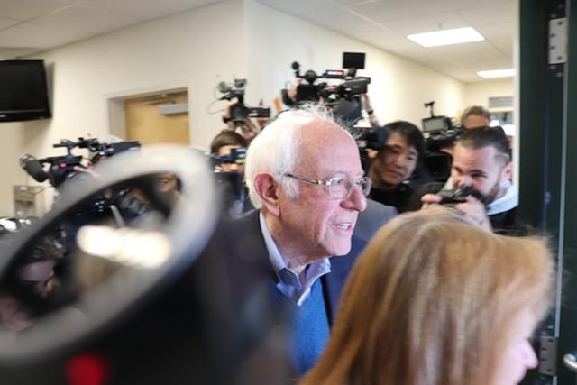 Sanders leaving the polls - DEREK BROUWER