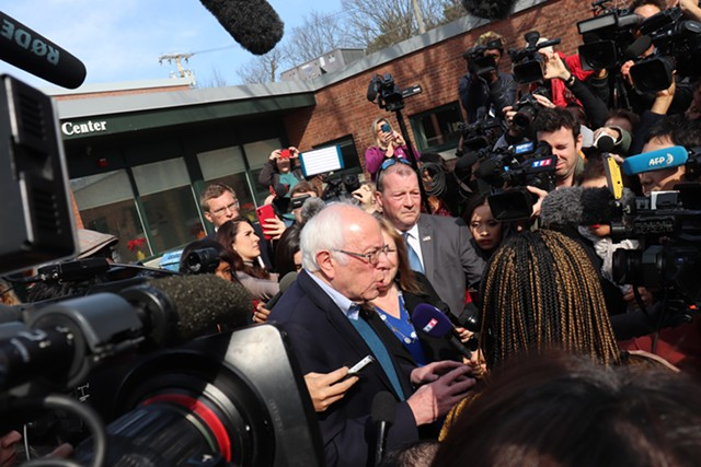 Bernie Sanders speaking to reporters outside the polls in Burlington on Tuesday - DEREK BROUWER