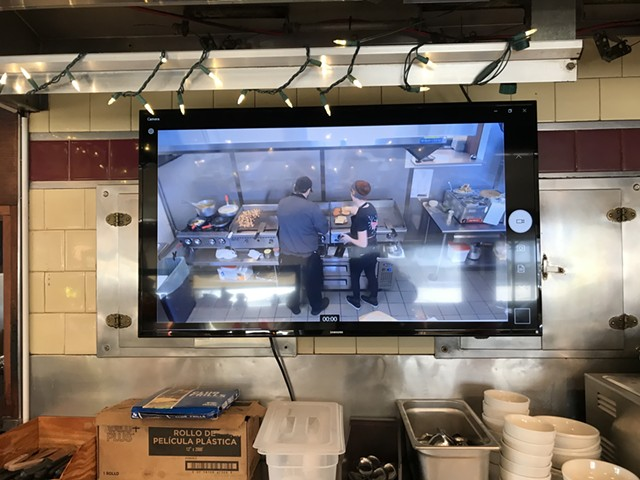 Cooks on television at Parkway Diner in South Burlington - SALLY POLLAK