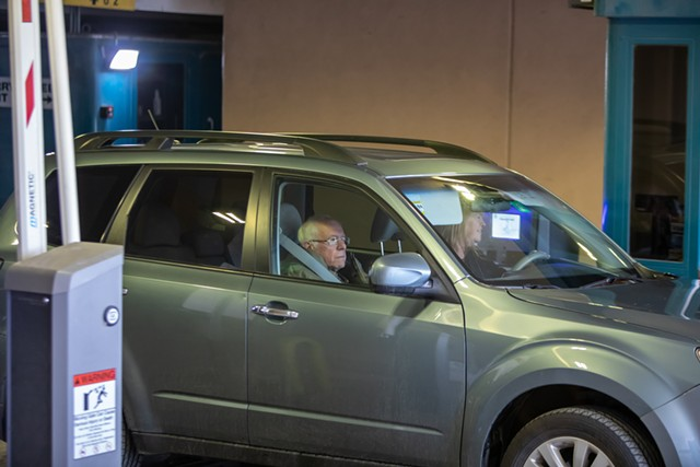 Jane O'Meara Sanders and Sen. Bernie Sanders depart Burlington's Hotel Vermont on Wednesday - LUKE AWTRY