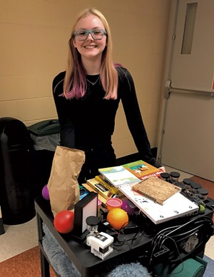 "Champlain Valley Union High School junior Maddie Evans with a ""stress-free"" cart she designed for her Think Tank elective"