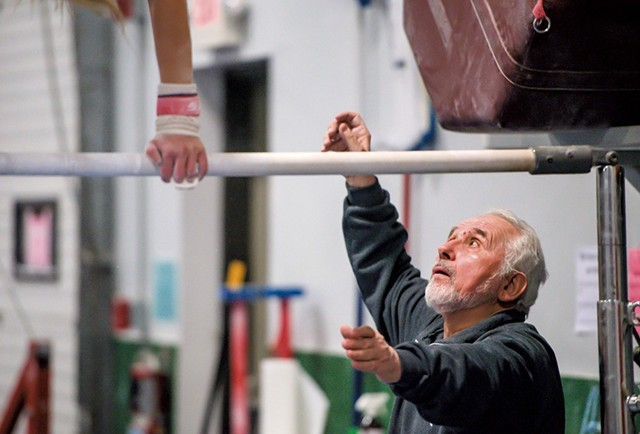 Coach Stefan Hruska working with a gymnast at the Green Mountain Training Center in Williston - GLENN RUSSELL