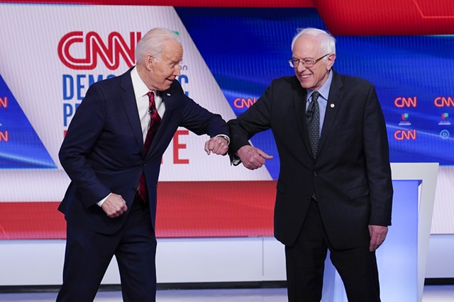 Former vice president Joe Biden and Sen. Bernie Sanders preparing to debate Sunday night in Washington, D.C. - ASSOCIATED PRESS