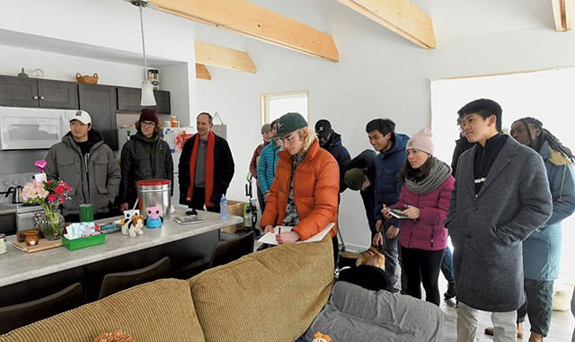 Middlebury College students from professor John McLeod's class visiting Dora Rivera's energy-efficient Habitat house - JON OLENDER