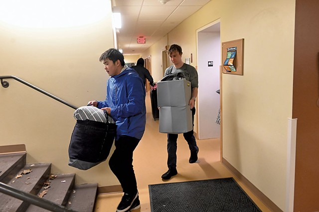 Middlebury College sophomores Aska Matsuda (left) and Sam deWolf moving out of their dorm - JON OLENDER