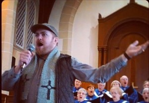 Adam Hall and choir - COURTESY OF SIMONE O'FLAHERTY