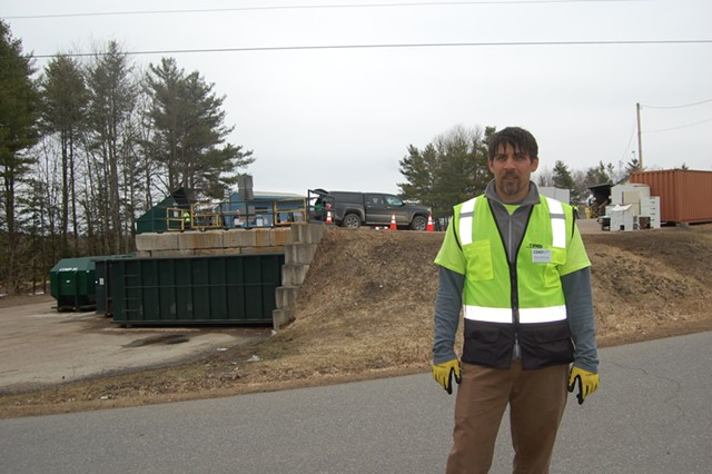 Ethan Hausman greeted people as they arrived to drop off trash. - MATTHEW ROY