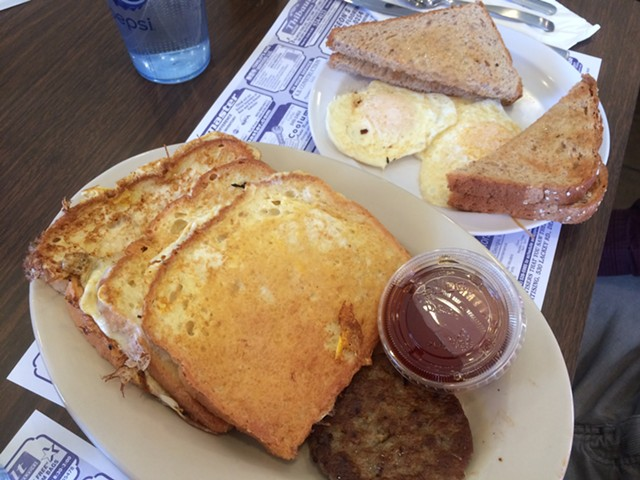 Three French Toast, $6.99, plus two eggs ($1) and more toast ($.75) - ALICE LEVITT