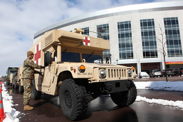 Vermont National Guard members arriving at the University of Vermont Medical Center to set up tents - KEVIN MCCALLUM