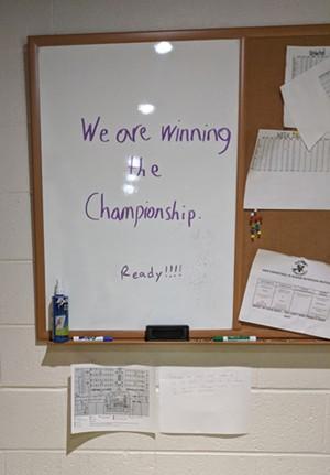 A sign in the men's locker room - COURTNEY LAMDIN