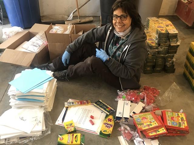 Arista Alanis packing art supply kits - COURTESY OF VERMONT STUDIO CENTER