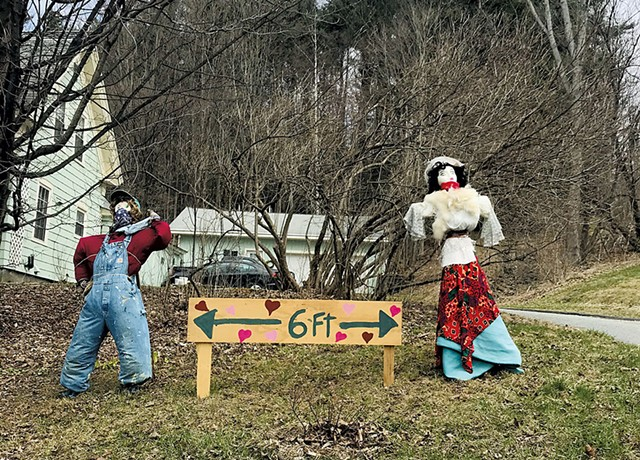 Photo submitted to the Vermont Historical Society's COVID-19 Archive in which scarecrows demonstrate proper social distancing in a Montpelier yard